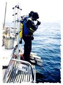 Diver's preparing for giant stride off the boat